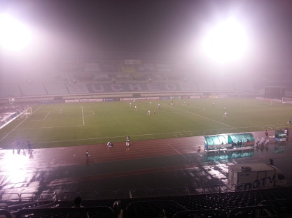 The rain, the mist and the running track. Not a great view of the match.