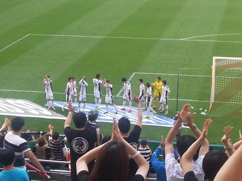 Seongnam players bow to their fans at the FT whistle.
