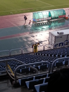 A sole Bucheon fan cheers on the team as they come out the tunnel!